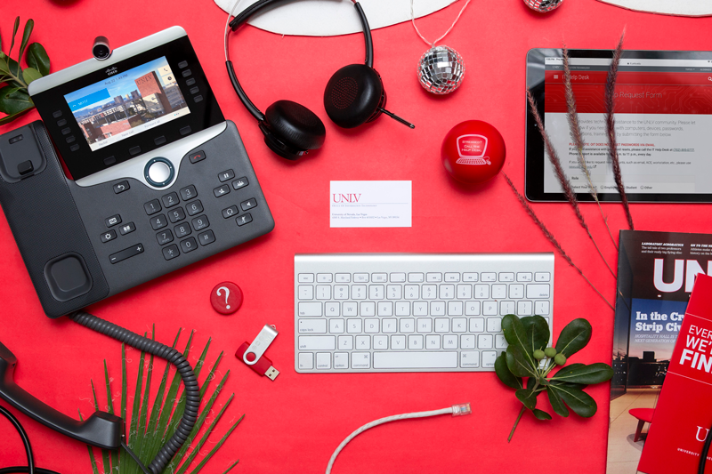 Top down view of help desk items on red background
